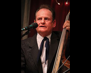 Jerry McCoury playing upright bass, wearing a tux, as a younger man